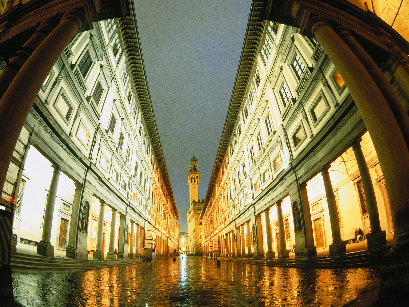 The Uffizi in Florence at night, in the background Palazzo Vecchio --- Image by © Wilfried Krecichwost/Corbis
